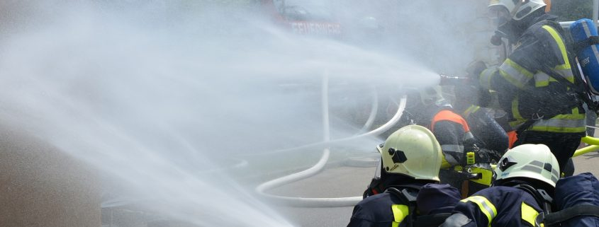 Fireproof coating applied to a burning building the fire department is taking in control