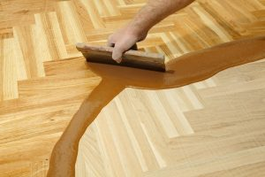 Applying polyurethane wood coatings to a wooden floor